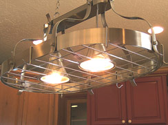 Hanging light with hooks to hang your pans... Perfect with center bar beneath...